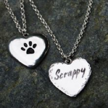 Engraved pawprint pendant